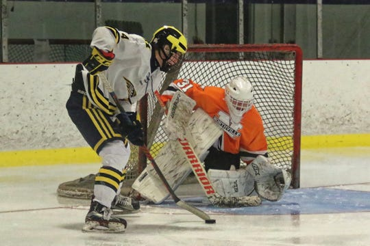 Hartland's Max McIllmurray prepares to take a shot against Northville goalie Conner Boucha on Wednesday, Dec. 12, 2018 at Hartland Sports Center.