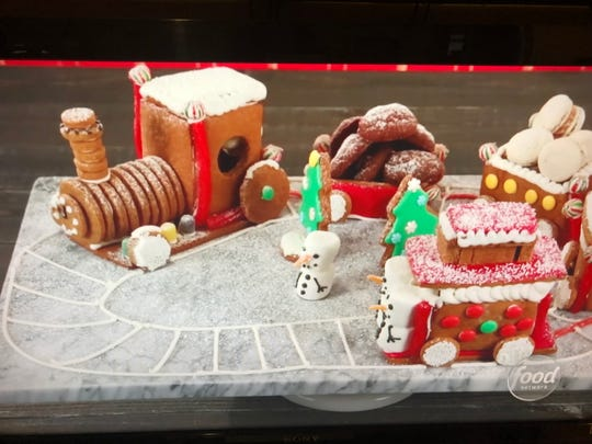 Lana Witherspoon of Hartland created this train made out of gingerbread with additional cookies for cargo in the Food Network Christmas Cookie Challenge show.