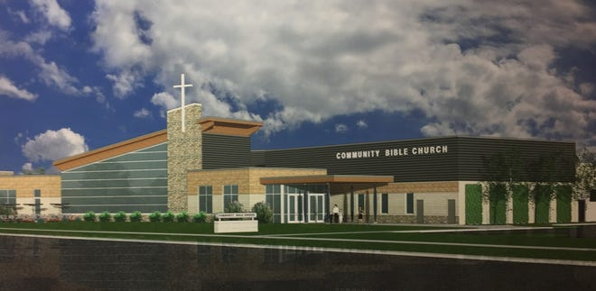 An architectural rendering hanging on a wall at Community Bible Church in Genoa Township, photographed Thursday, Dec. 13, 2018, shows what the church will look like after a major expansion.
