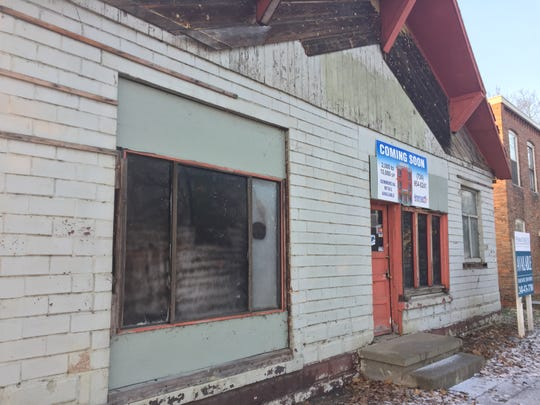A former auto shop at 211 Main Street in Pinckney, shown Thursday, Dec. 13, 2018, still needs some work, but the building has been partially fixed up to rent out to businesses. TruFit Fitness PInckney is open in the back of the building.