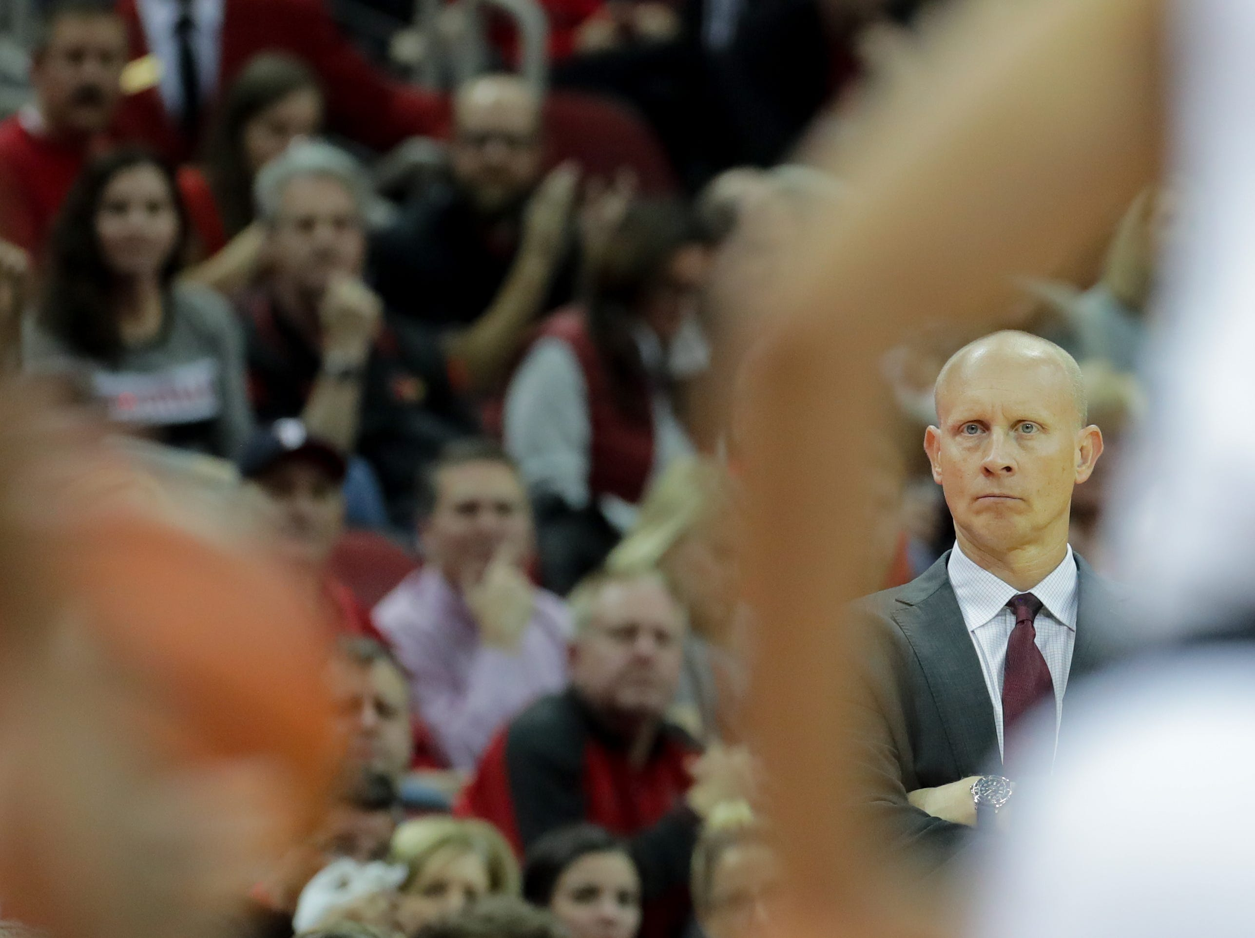 Louisville's Chris Mack watches the action from the sideline.     
