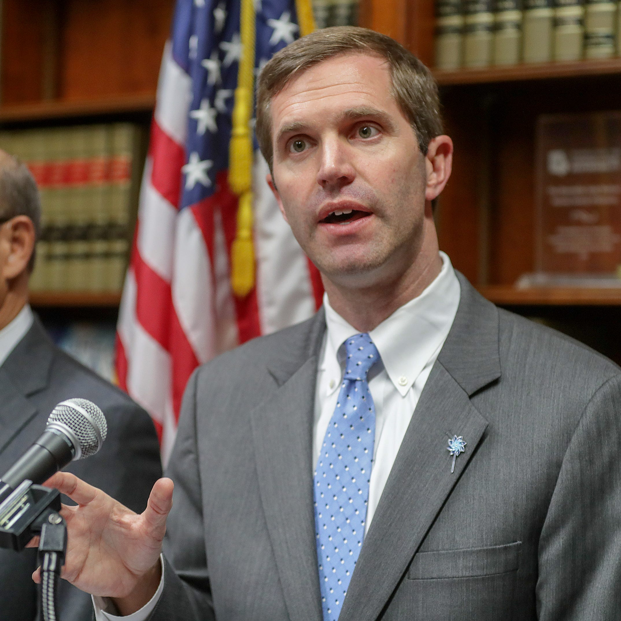 Kentucky Attorney General Andy Beshear speaks with the media after a Kentucky Supreme Court ruling that overturned Governor Matt Bevin's pension reform bill.