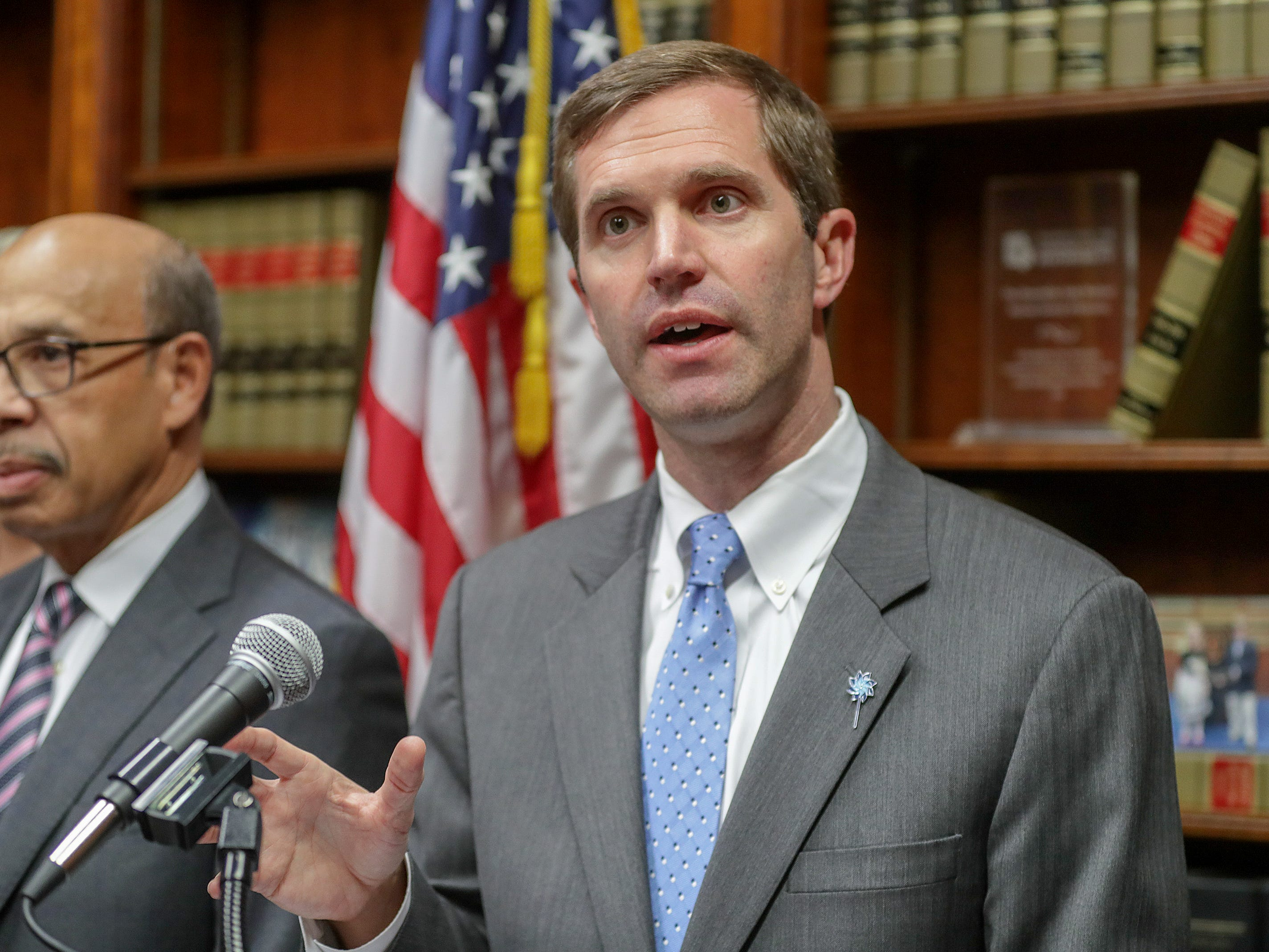 Kentucky Attorney General Andy Beshear speaks with the media after a Kentucky Supreme Court ruling that overturned Governor Matt Bevin's pension reform bill.December 13, 2018