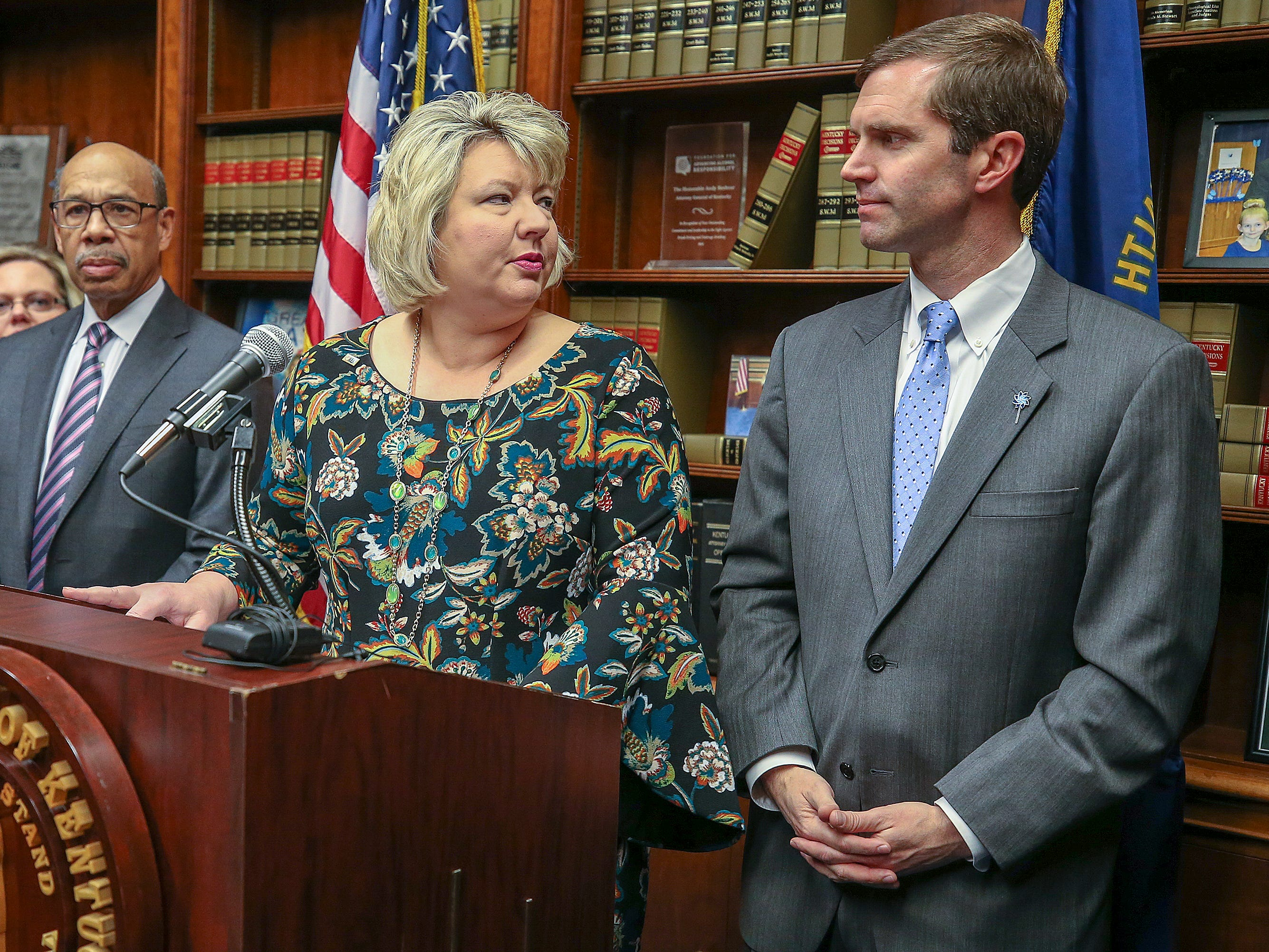 Stephanie Winkler, current president of KEA, speaks during a press conference with Kentucky Attorney General Andy Beshear after a Kentucky Supreme Court ruling that overturned Gov. Matt Bevin's pension reform bill. December 13, 2018