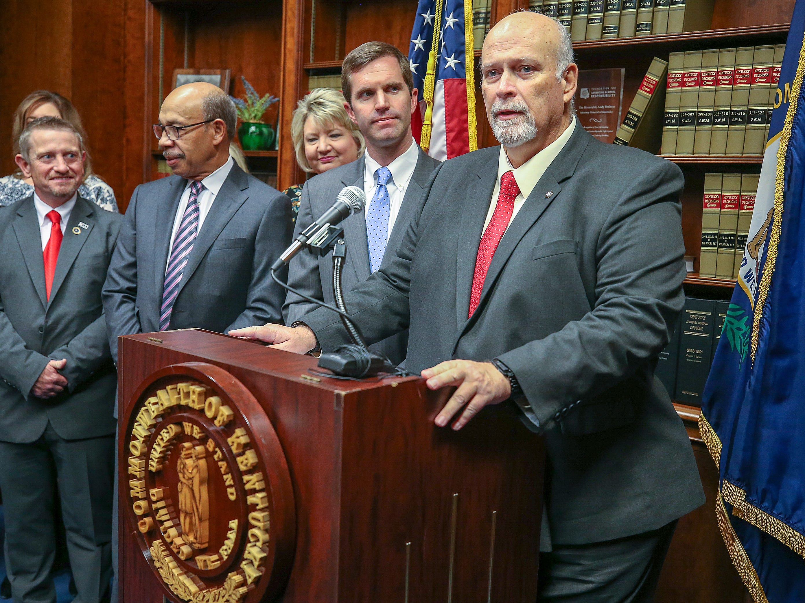 Jerry Powell, with the FOP, speaks during a press conference with Kentucky Attorney General Andy Beshear after a Kentucky Supreme Court ruling that overturned Gov. Matt Bevin's pension reform bill. December 13, 2018