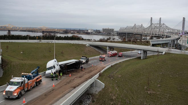 A tractor trailer overturned on the exit ramp from I64 west to I 65 south, shutting down the ramp and causing a long delay in the morning commute. Dec. 13, 2018.