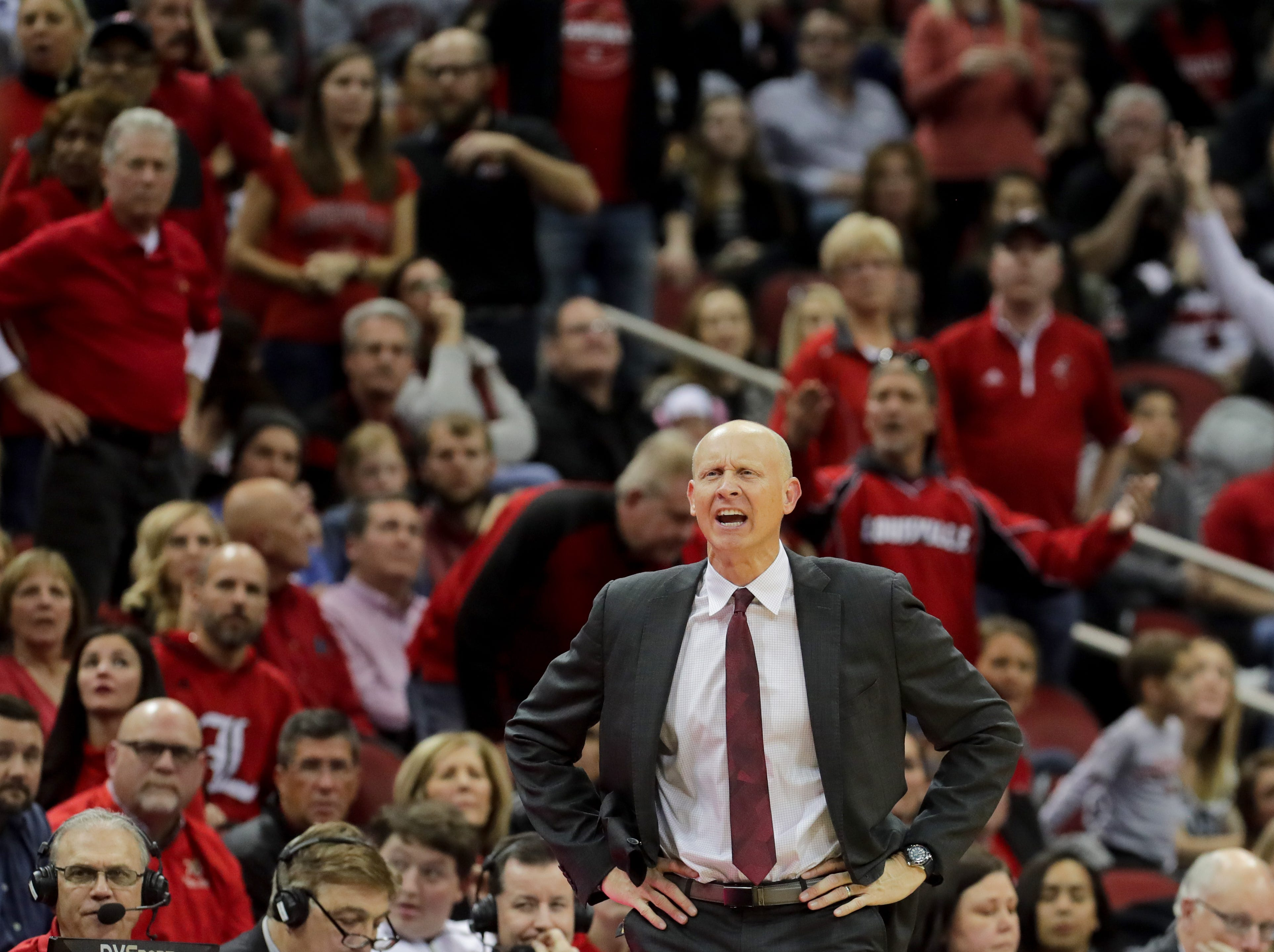 Louisville's Chris Mack coaches from the sideline.     