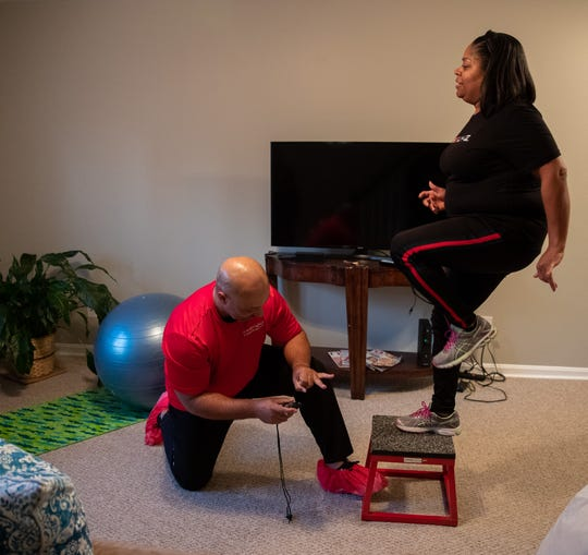 Felicia Patterson works out with GymGuyz coach Roy Elmore.