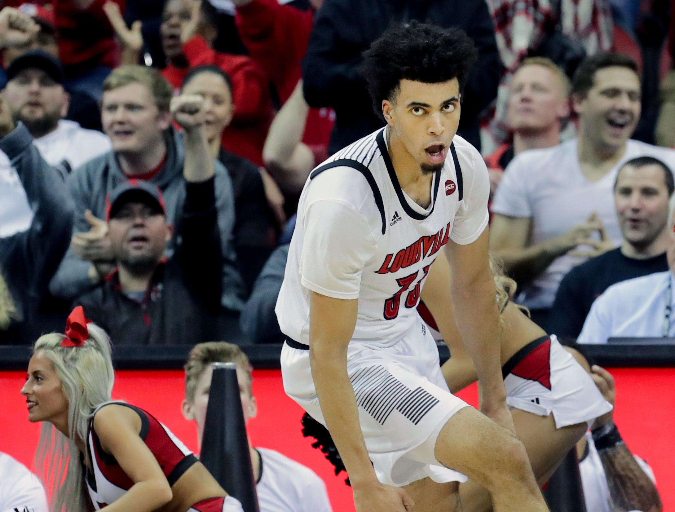 Louisville Jordan Nwora celebrates after dunking on Lipscomb.    