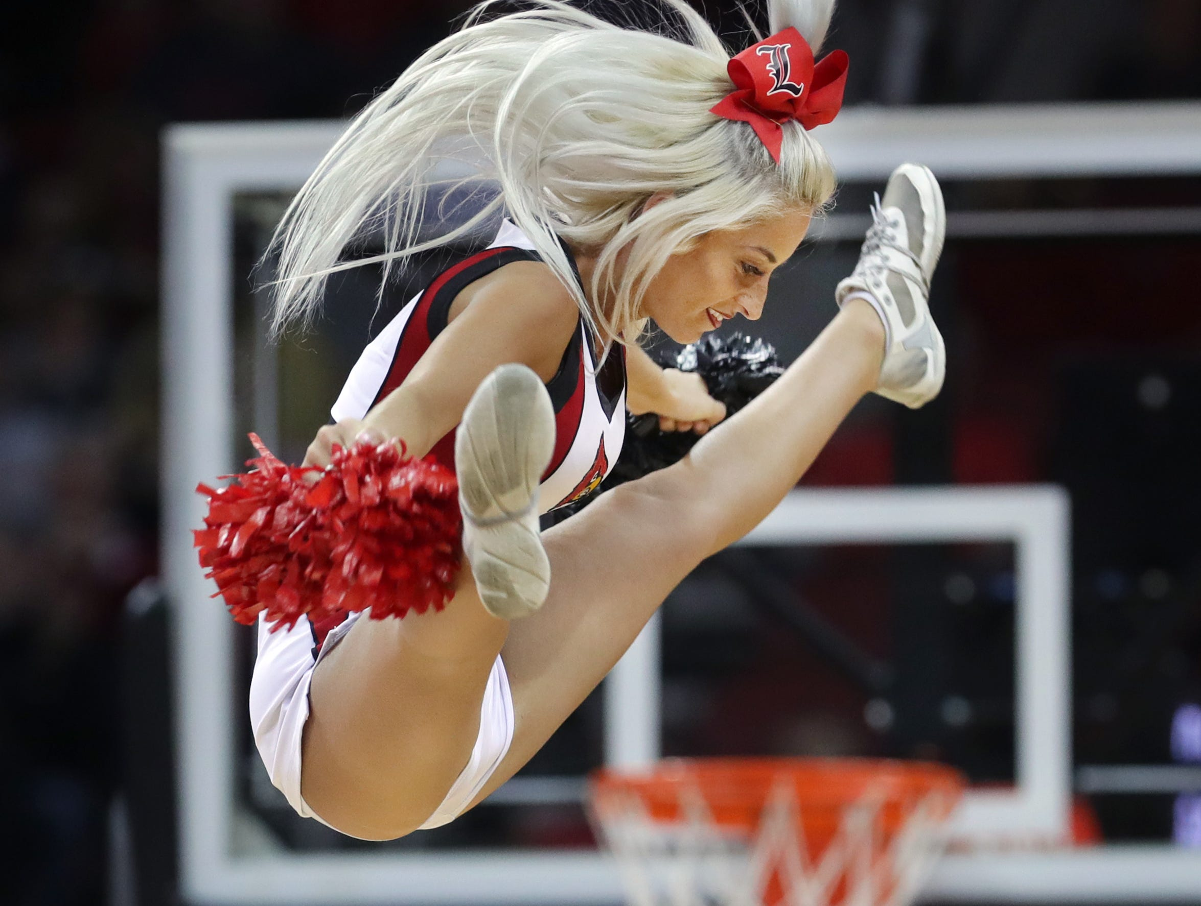 The Louisville cheerleaders entertain the crowd during a timeout.  