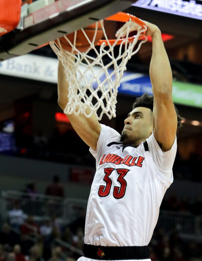 Louisville Jordan Nwora with the slam dunk.   