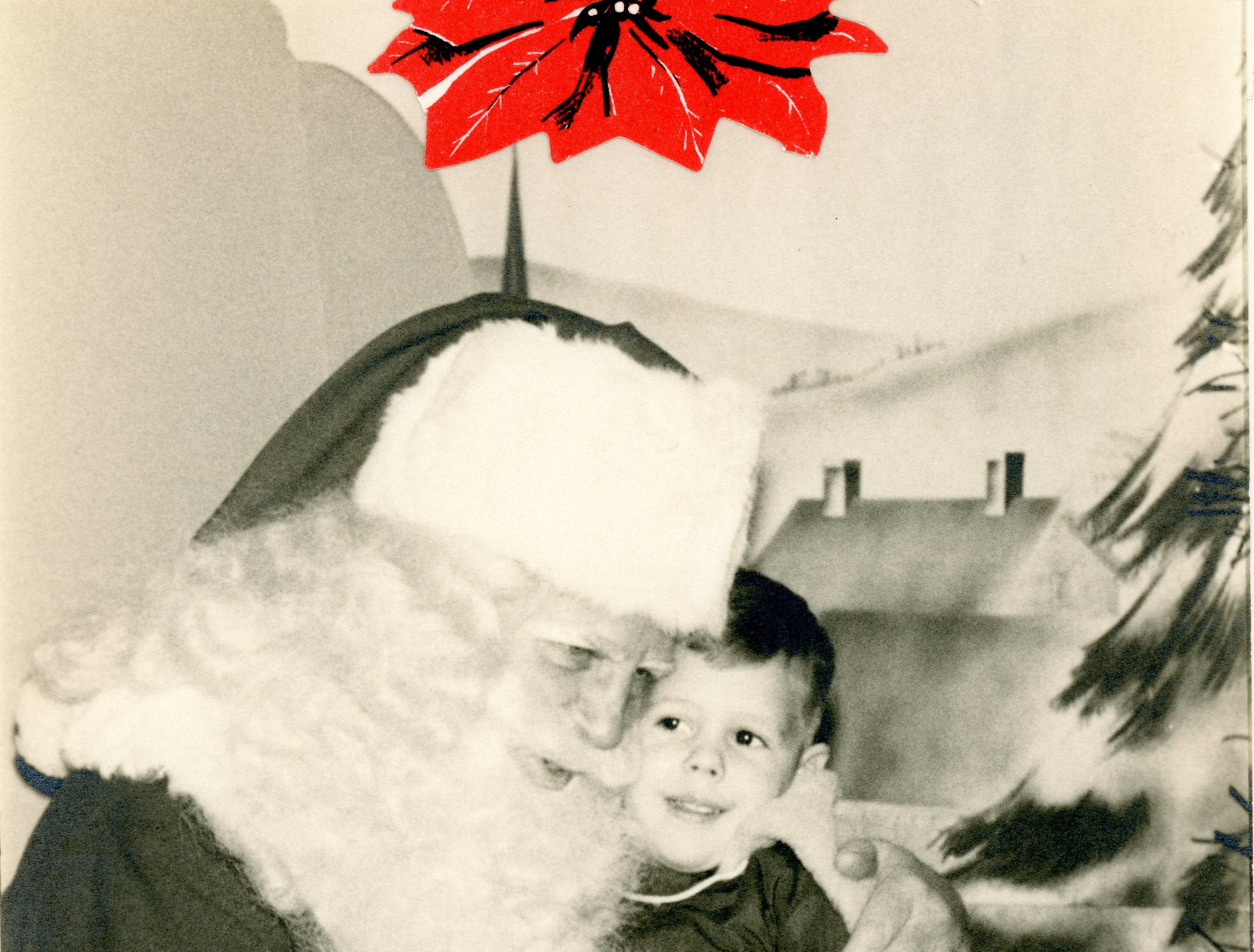 Jim Perkins takes a photo with Santa at Knapp's, date unknown.