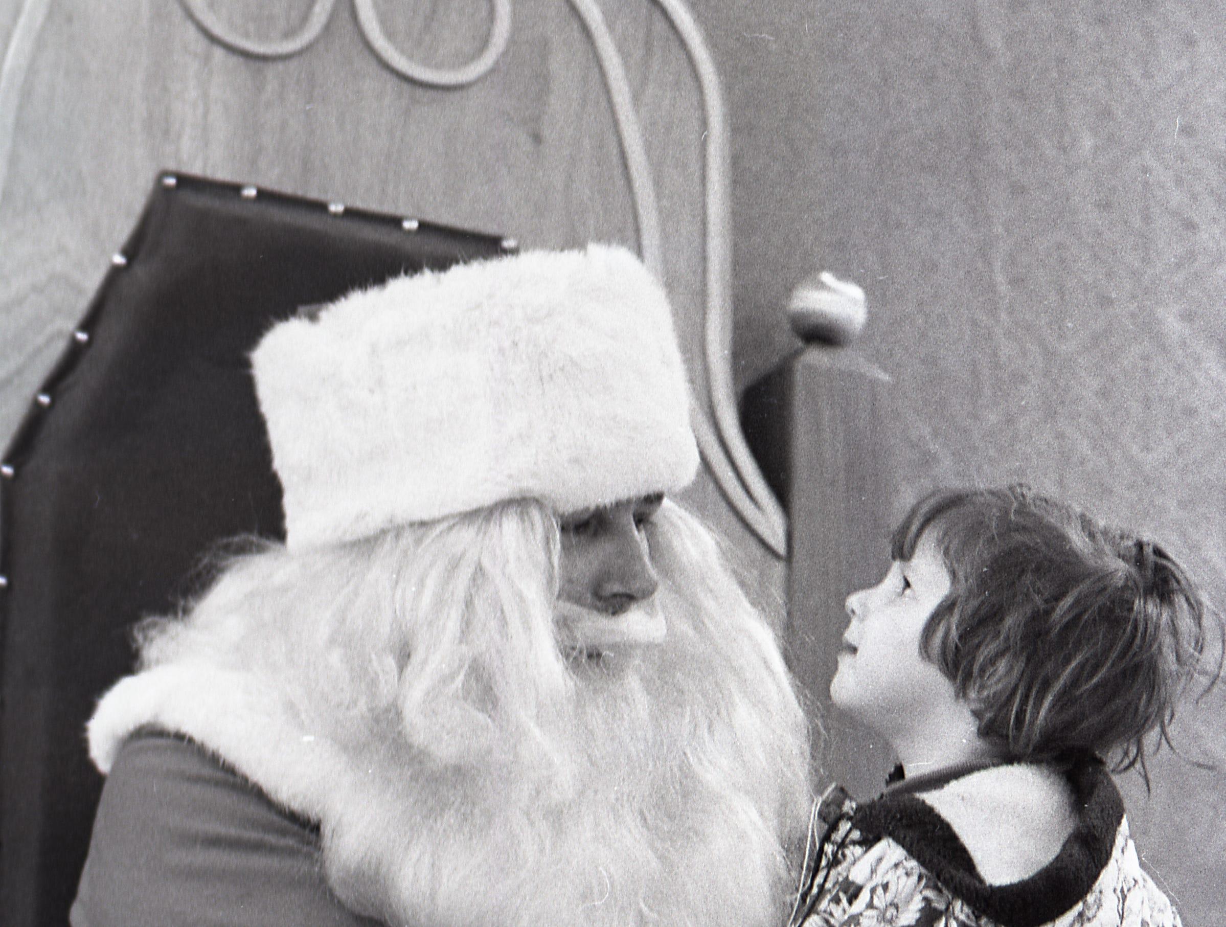A child pays a visit to Santa, Nov. 30, 1971.