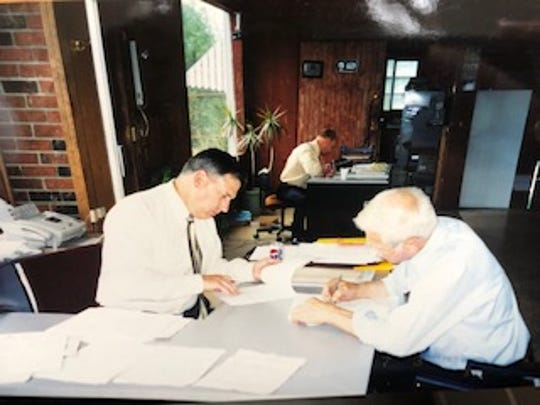 Eldon Howe (right) at work at Beacon Sales & Service several years before the March 2018 accident that sidelined his ability to be there every day.