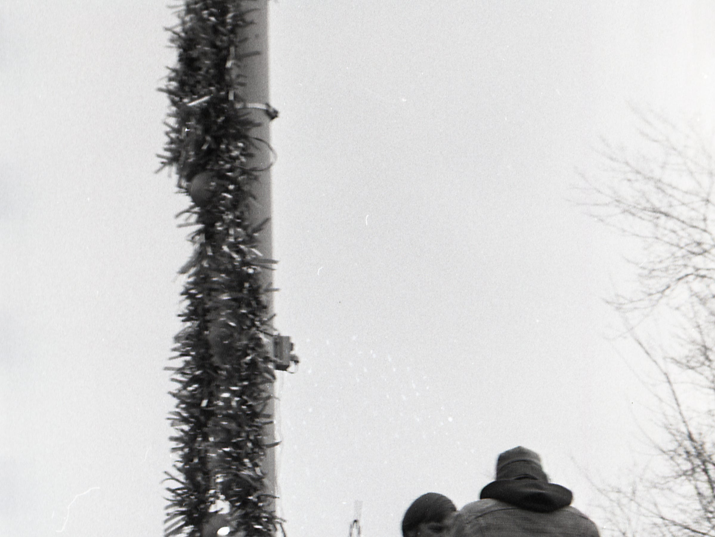 Christmas decorations on Grand River Avenue in East Lansing, Nov. 25, 1977.