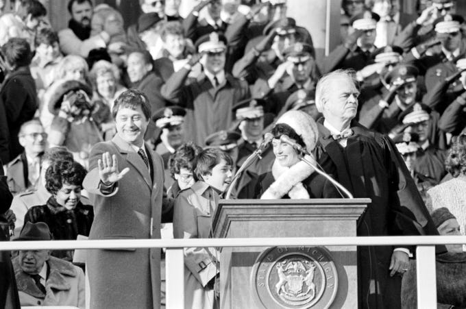 Former Gov. James Blanchard (D) waves to a crowd of supporters during his inaugural ceremony, January 1, 1983,  at the state Capitol downtown, Lansing.