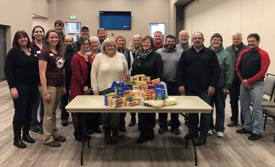 Pictured is Farm Wisconsin Board of Directors and staff along with a representative from Peter's Pantry after the board donated butter and cheese to the pantry.