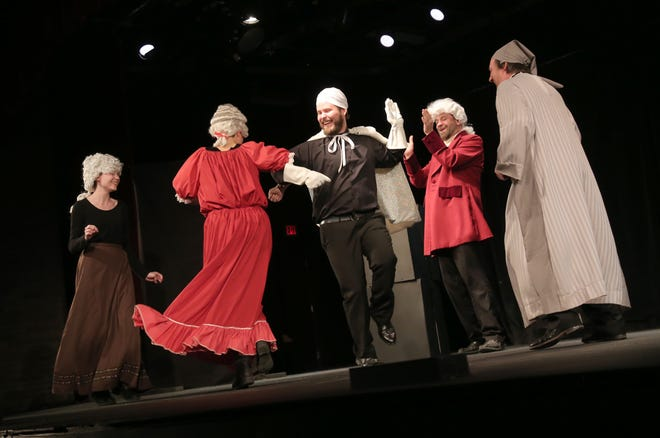"""Cast members of the OSU-Mansfield production of """"A Christmas Carol"""" dance while rehearsing a scene on Wednesday."""