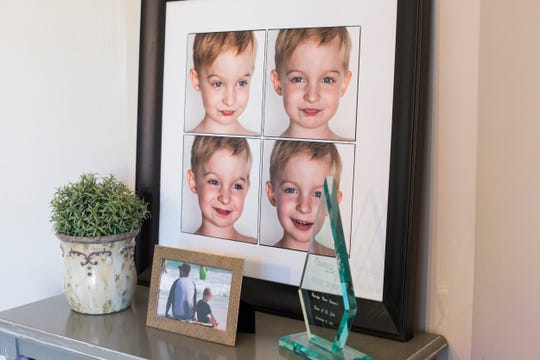 December 13 2018 - Photos of Trevor are seen inside of Lisa Trumbo's home. Trumbo is a bereaved parent mentor who is helping other parents cope with loss at St. Jude Children's Research Hospital. Her son, Trevor, was a St. Jude patient who died of a brain tumor at just 4 years old.