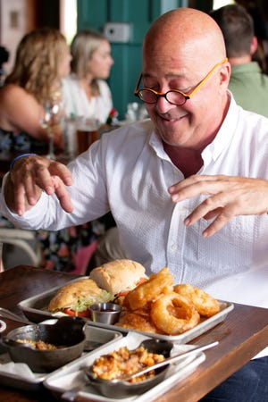 Host Andrew Zimmern ready to attack his po'boy sandwich at Second Line, as seen on Travel Channel's The Zimmern List.