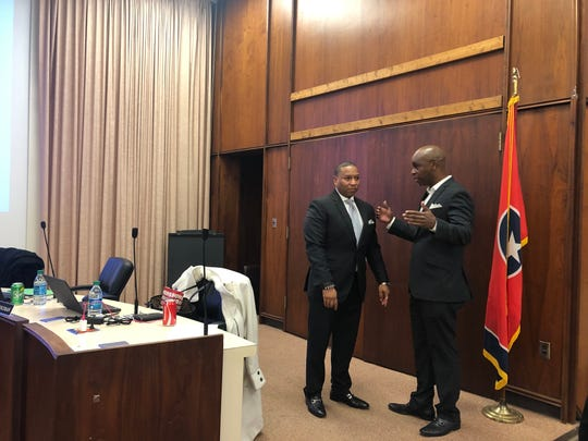Interim Superintendent Joris Ray, on left, speaks with soon-departing Superintendent Dorsey Hopson minutes after Ray was named the interim head of the district.