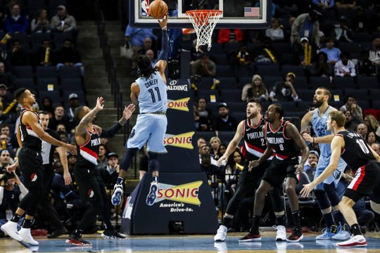 December 12 2018 - Grizzlies' Mike Conley goes up for a shot during Wednesday night's game versus the Portland Trail Blazers at the FedExForum.