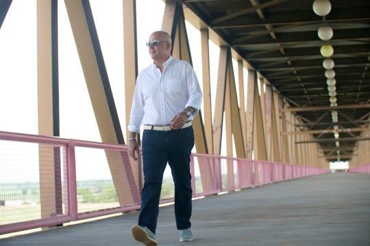 Host Andrew Zimmern walks across the Mud Island bridge when he was in town filming season two of Travel Channel's The Zimmern List.