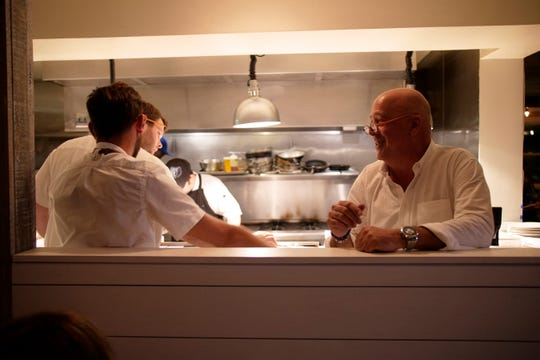 Host Andrew Zimmern and chefs Andrew Ticer and Michael Hudman film a scene at Hog & Hominy for Travel Channel's The Zimmern List.