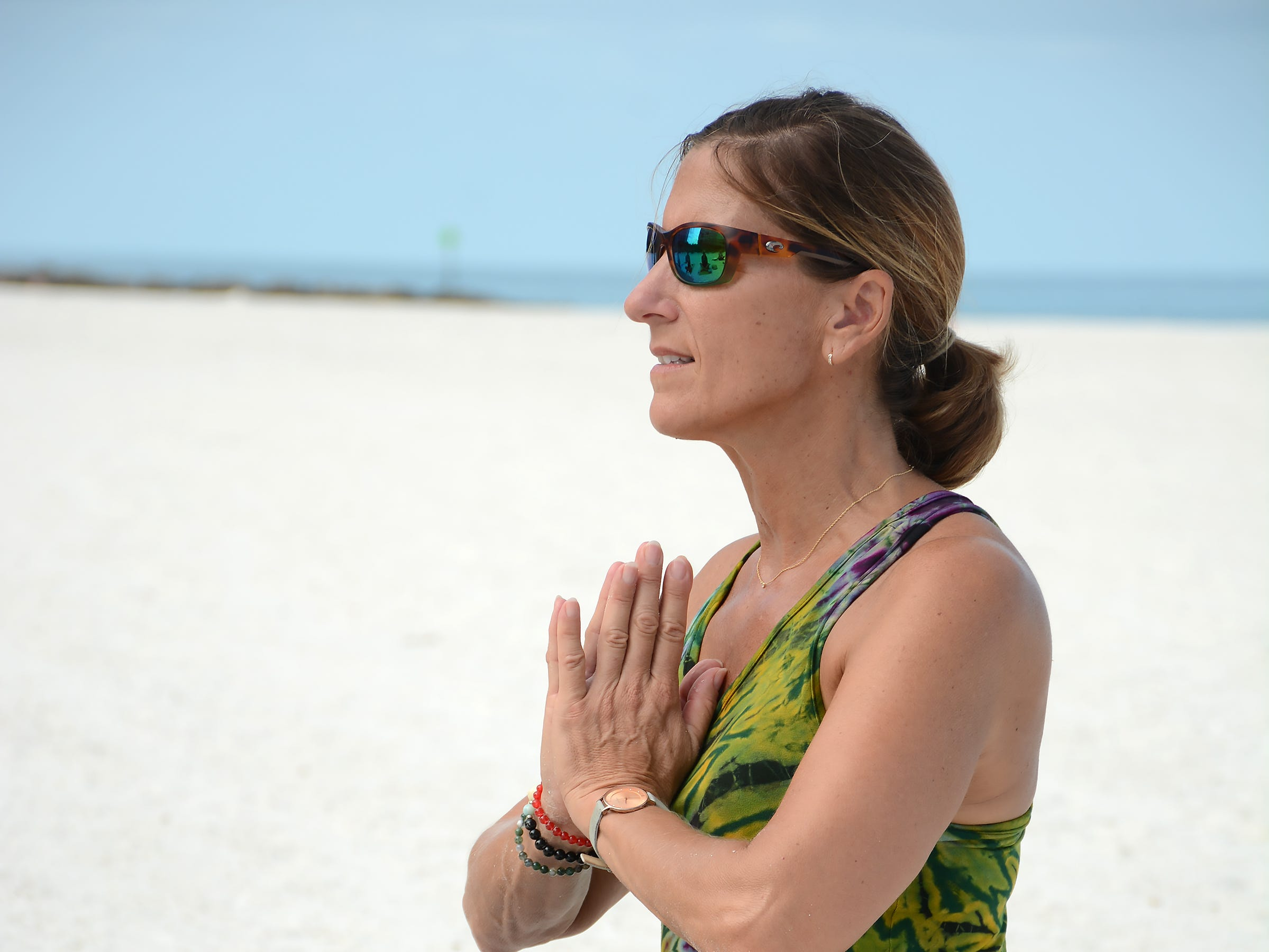 Instructor Laurie Kasperbauer leads a morning class in this file photo. Marco Island Yoga and Revival Yoga Fitness Studio will join together in a yoga class to raise funds for victims of the shooting at a Tallahassee yoga studio.
