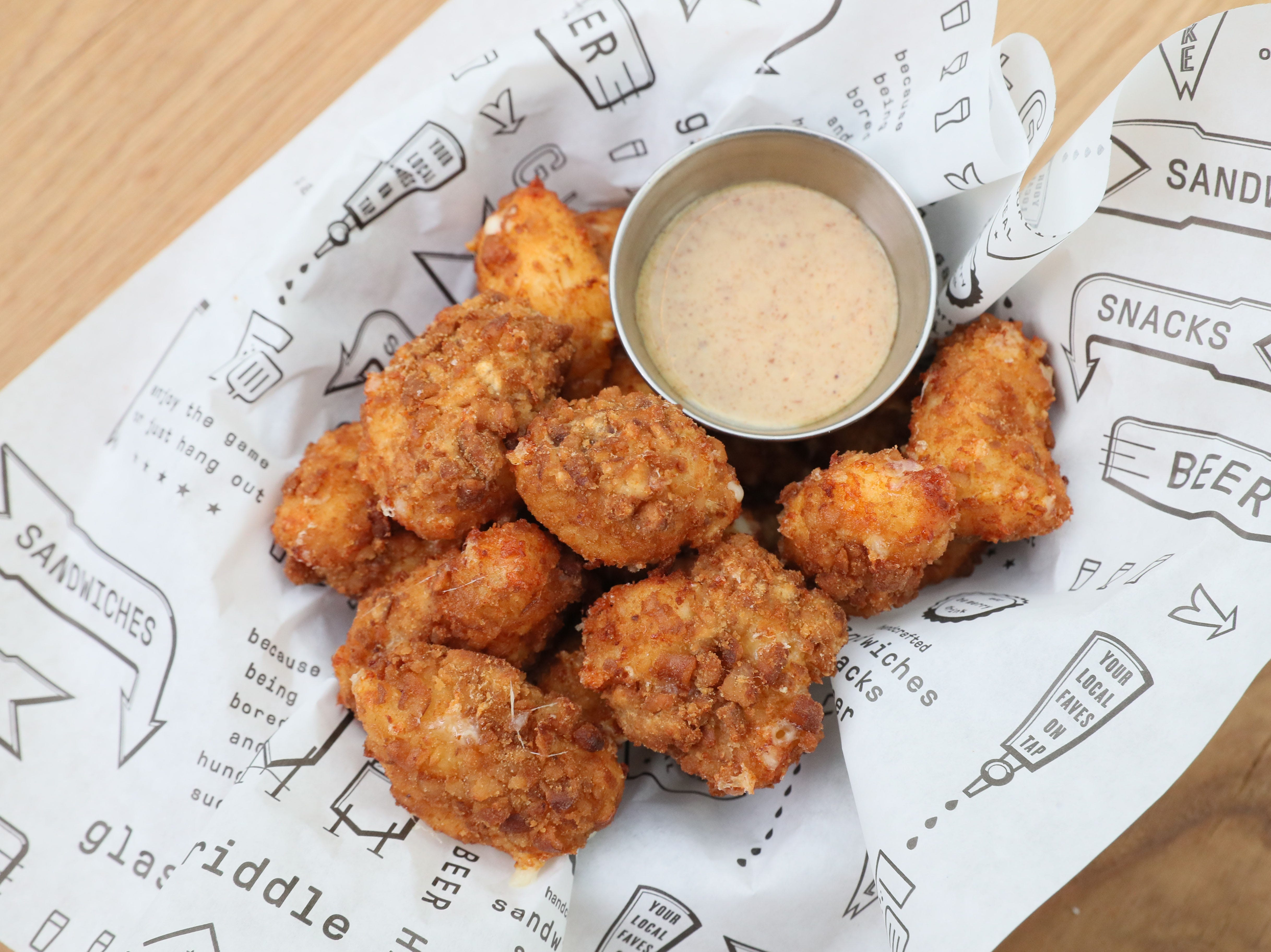 Crushed pretzels in the breading help make cheese curds especially crunchy at Glass + Griddle.
