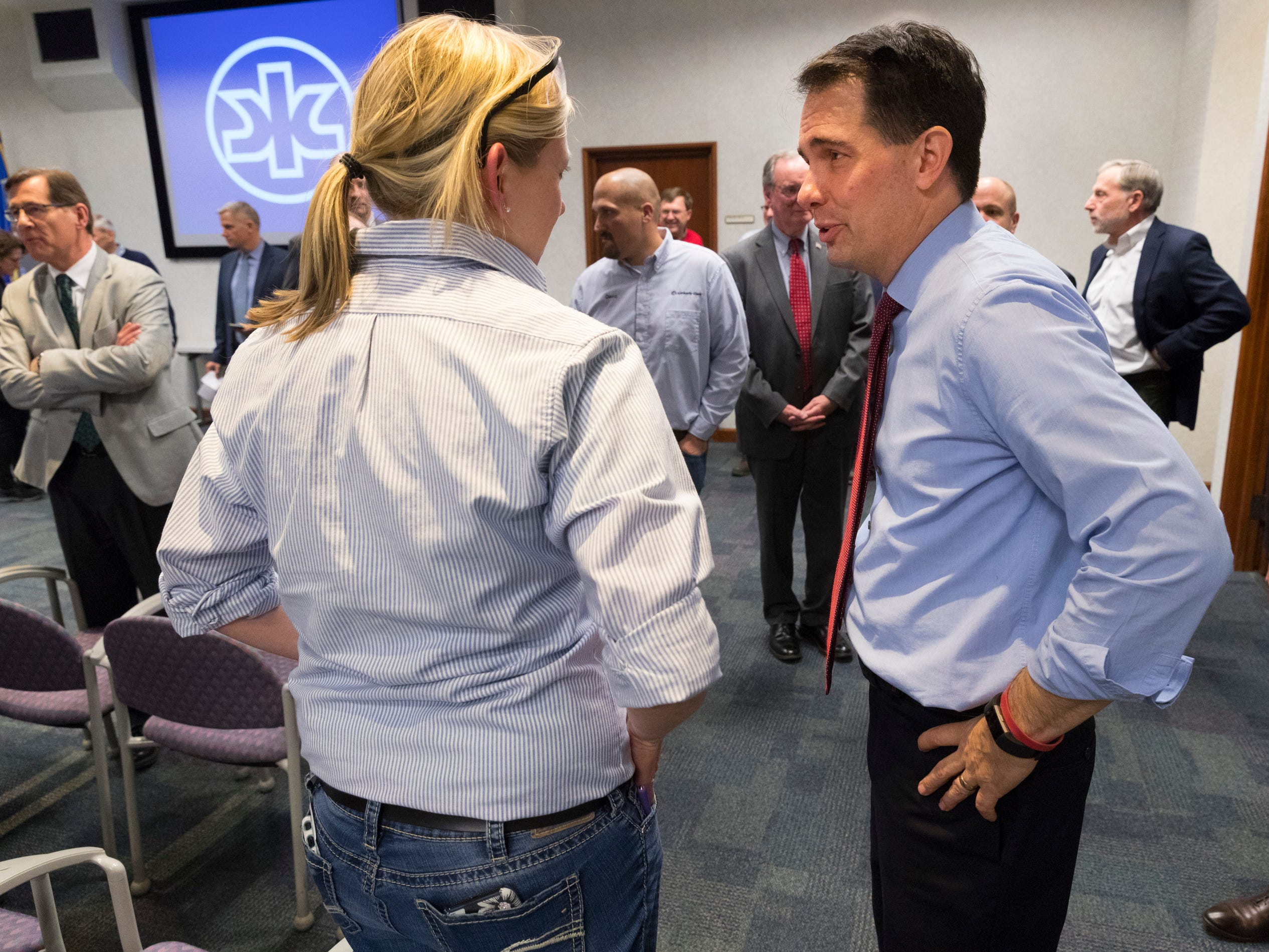 Gov, Scott Walker (right) speaks to a worker at Kimberly Clark's Cold Spring plant.