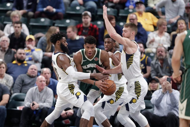 Giannis Antetokounmpo of the Bucks drew a crowd of Pacers every time he touched the ball on Wednesday night.