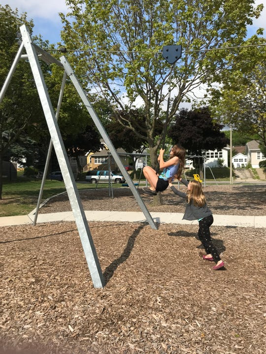 The zipline at Marcus DeBack playground is fun for kids (and adults) of all ages.
