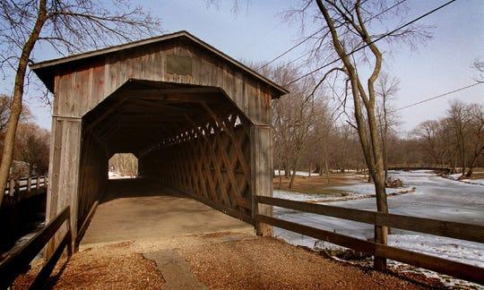 Cedar Creek flows below the historic bridge at Covered Bridge Park in the Town of Cedarburg.