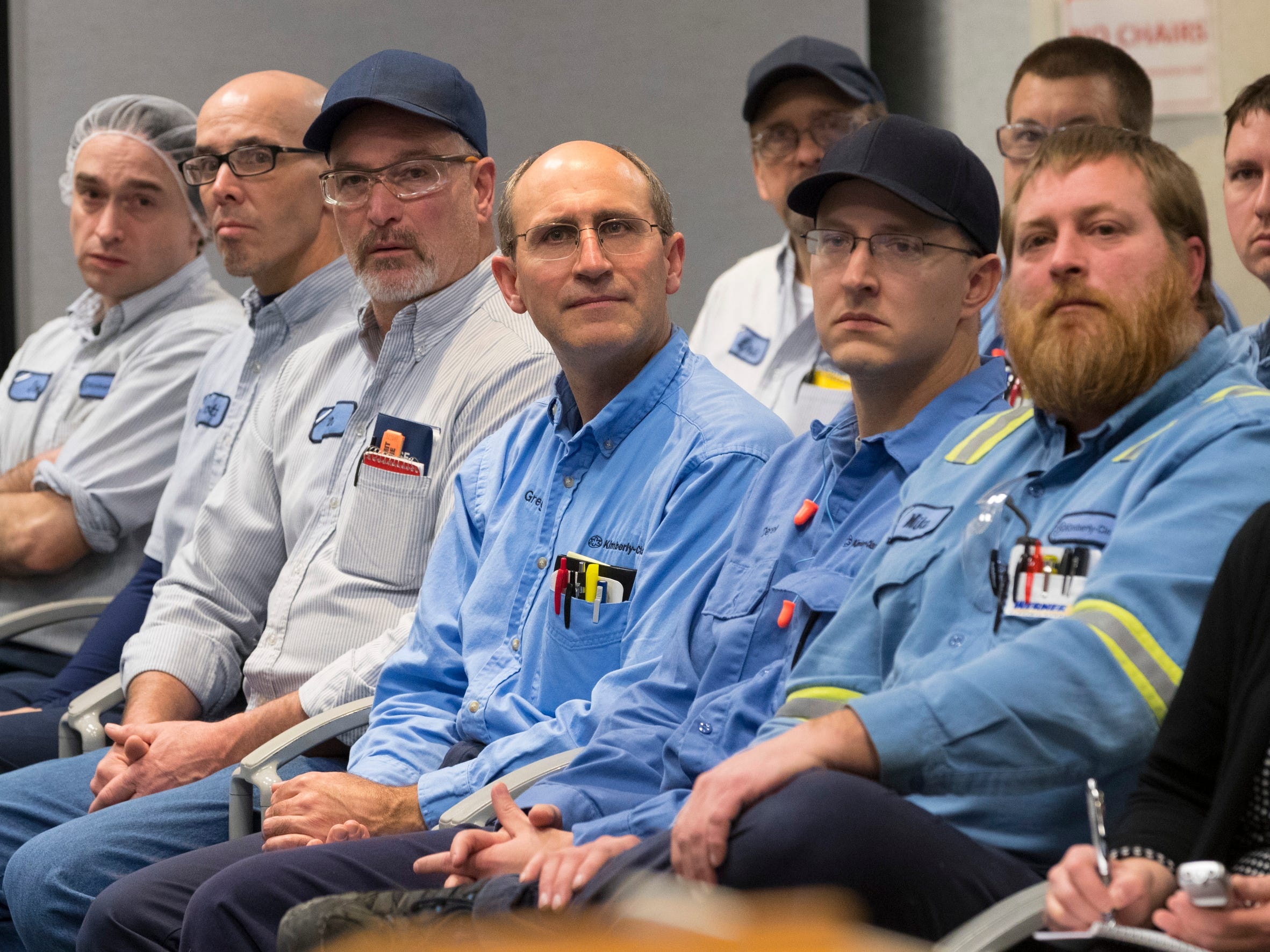 Workers listen to Gov. Scott Walker speak about a deal to keep their plant open Thursday at Kimberly Clark's Cold Spring plant.