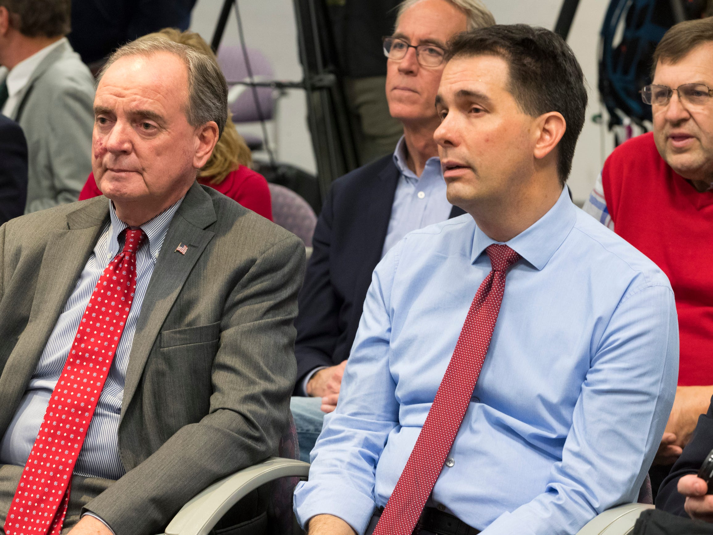 Gov. Scott Walker (right) sits next to Mark R. Hogan, the CEO of Wisconsin Economic Development Corp., Thursday at Kimberly Clark's Cold Spring plant.