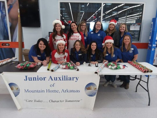 Members of the Junior Auxiliary of Mountain Home recently wrapped presents for children partcipating in the annual Shop With a Cop campaign conducted by local law enforcement.