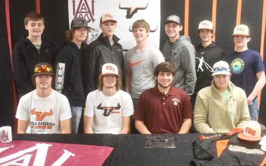 Members of the Viola Longhorns baseball team join Will Wilson at his signing ceremony Wednesday.