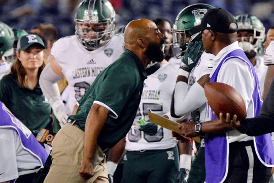 Sep 22, 2018; San Diego, CA, USA; Eastern Michigan Eagles defensive backs coach Fred Reed (center) yells at defensive back Ross Williams (14) after Williams got called for pass interference in the fourth quarter against the San Diego State Aztecs at SDCCU Stadium. Mandatory Credit: Jake Roth-USA TODAY Sports