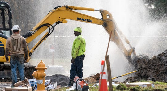 Water sprays from. A broken line as workers replace trouble water lines in the Newtown neighborhood in Montgomery, Ala., on Wednesday December 12, 2018.