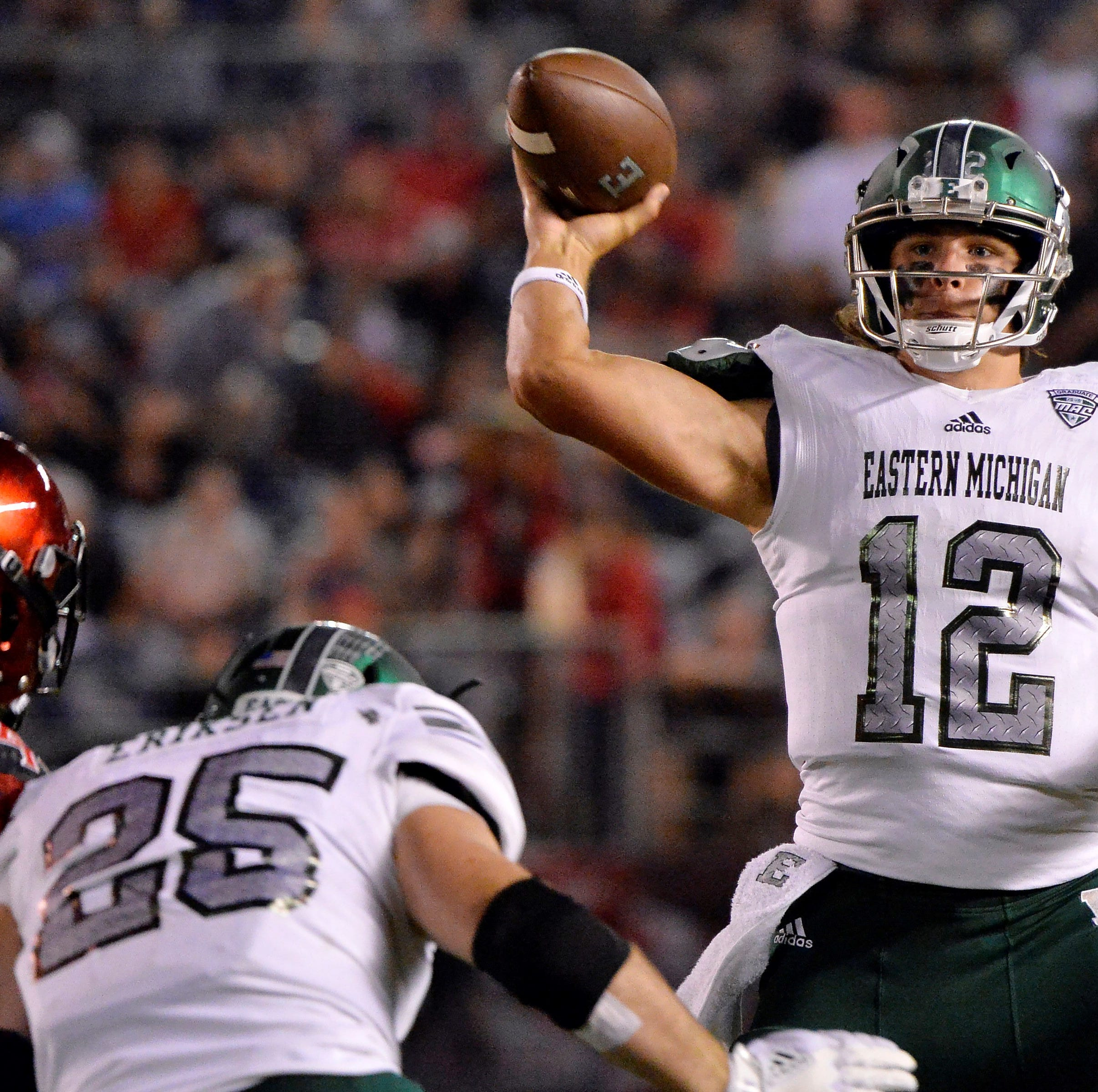 Sep 22, 2018; San Diego, CA, USA; Eastern Michigan Eagles quarterback Tyler Wiegers (12) jumps to pass during the second quarter against the San Diego State Aztecs at SDCCU Stadium. Mandatory Credit: Jake Roth-USA TODAY Sports