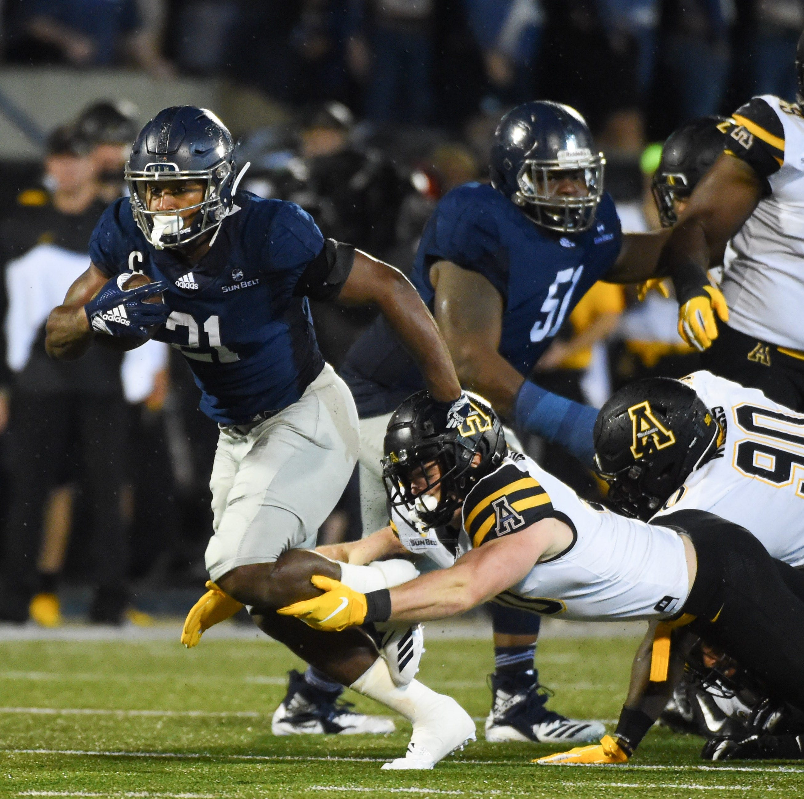 Oct 25, 2018; Statesboro, GA, USA; Georgia Southern Eagles running back Wesley Fields (21) carries the ball against Appalachian State Mountaineers linebacker Logan Doublin (40) during the second half at Allen E. Paulson Stadium. Mandatory Credit: Adam Hagy-USA TODAY Sports
