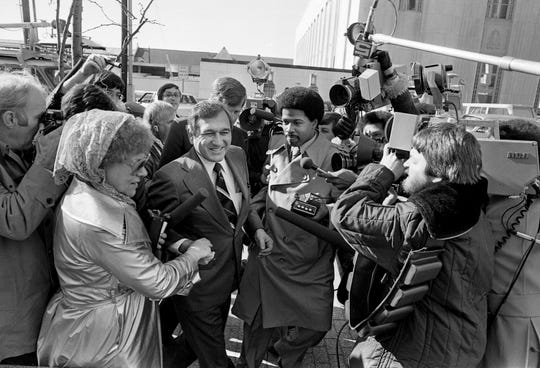 Gov. Ray Blanton, center, is all smiles as he arrives at the federal courthouse Dec. 22, 1978, for an appearance before a federal grand jury probing alleged selling of pardons and commutations.