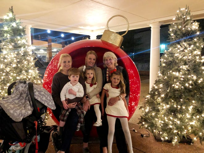 """Ms. Cheap and her daughters and grandchildren made Gaylord Opryland's """"Country Christmas"""" a holiday tradition, taking advantage of free festivities and decorations. The giant red ornament is a fun place to take a family photo."""