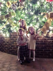 The beautifully decorated 48-foot tall Christmas tree in the Delta Atrium at the Gaylord Opryland resort is a festive backdrop for a photo of Ms. Cheap's grandkiddos: Maddie and Brinkley Miller and Beck Tefel.