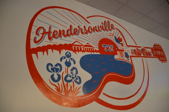 The murals inside Slim Chickens in Hendersonville were hand-drawn by a local artist.
