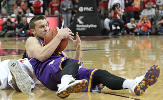 Lipscomb's Garrison Mathews comes up with a loose ball in Wednesday night's game against Louisville at the KFC YUM Center.