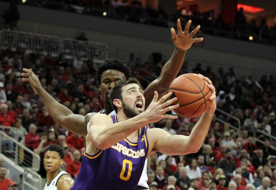 Lipscomb's Rob Marberry struggles to get a shot off against Louisville's defense in Wednesday night's game at the KFC YUM Center.
