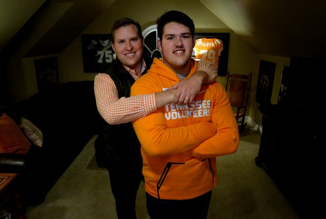 Montgomery Bell Academy offensive guard Jackson Lampley and his father, former University of Tennessee football player Brad Lampley at their home, Wednesday, Dec. 12, 2018, in Franklin, Tenn. Jackson will be continuing playing football at UT.