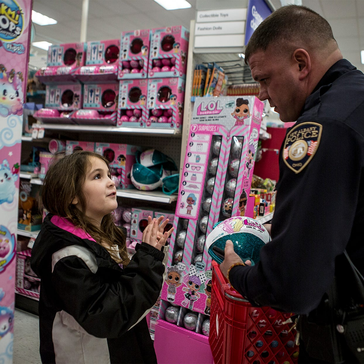 Families' holidays brightened by 'Shop with A Cop'
